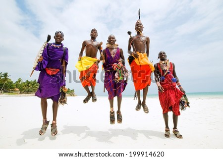 Africa. Kenya. Mombasa. Diani beach. January 28, 2012 Maasai men jumping.  - stock photo