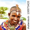 AFRICA,KENYA, SAMBURU,NOVEMBER 8: Portrait of Samburu  woman wearing traditional handmade accessories,  review of daily life of local people, near Samburu Park National Reserve, November 8,2008,Kenya - stock photo