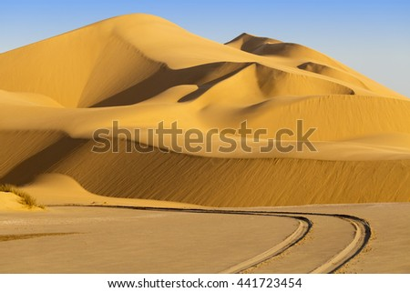 Africa. Landscape of dunes in Sossusvlei with wind shapes the sand dunes, Namibia, sunrise scene - stock photo