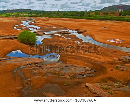 Africa. Mozambique.  Prospect of river with washing people. - stock photo