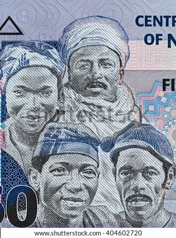 Africa people faces on Nigeria 50 naira banknote close up macro, African Nigerian money closeup - stock photo