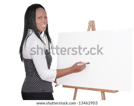 African American adult female giving a business presentation at a seminar over white - stock photo
