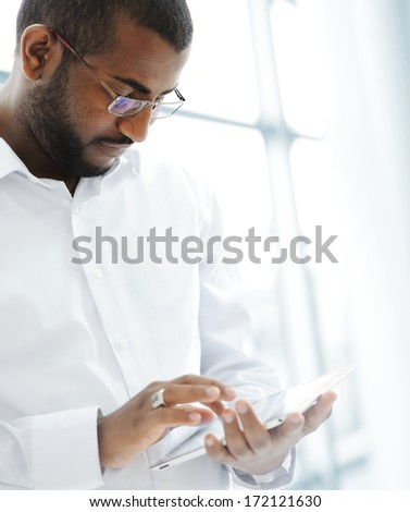 African American Arabic businessman with pc tablet