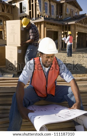 African American architect at construction site - stock photo