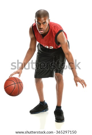 African American basketball player dribbling ball isolated over white background