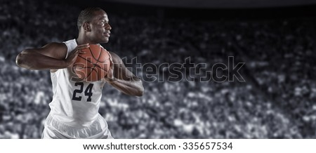 African American Basketball Player in a large basketball arena - stock photo