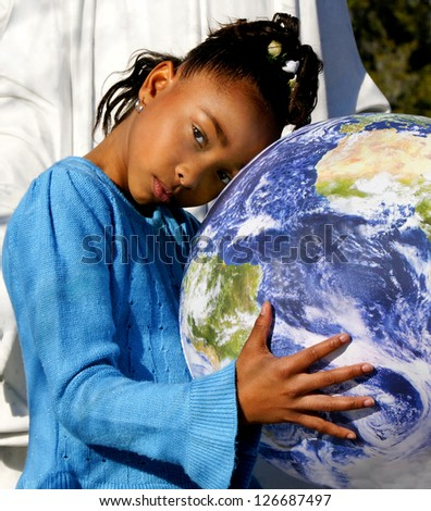 African-American black girl holding the NASA Earth ball.