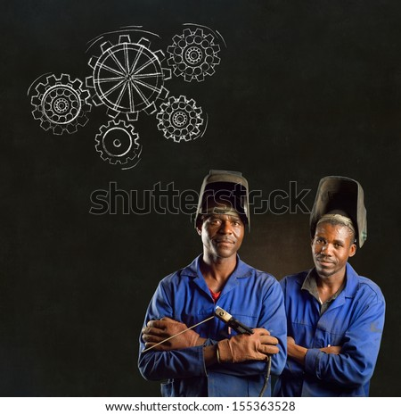 African American black men industrial workers with chalk gears on a blackboard background - stock photo