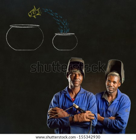 African American black men industrial workers with chalk jumping fish bowls on a blackboard background - stock photo