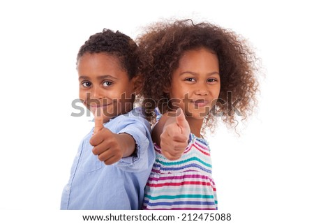 African American boy and girl making thumbs up gesture, isolated on white background - Black people - stock photo