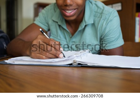 African American boy doing homework - stock photo