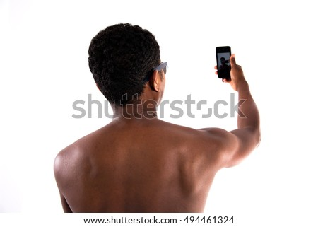 African American boy getting a selfie with the phone back on white isolated background