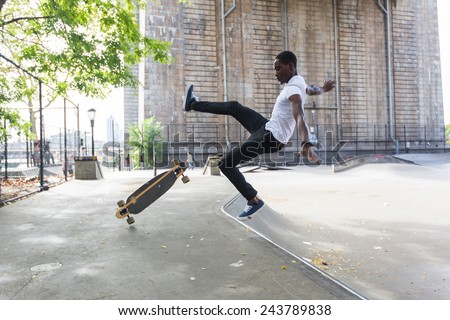 African american Boy Skating at Park and Falling Down - stock photo