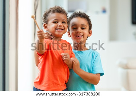 African american brothers child playing together - stock photo