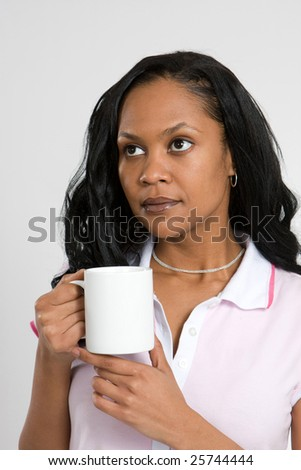 African American business woman drinking coffee - stock photo