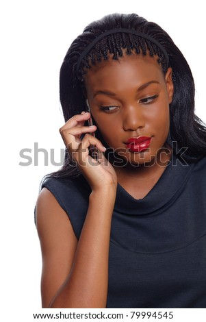 African American business woman listens seriously on the cellphone over white background