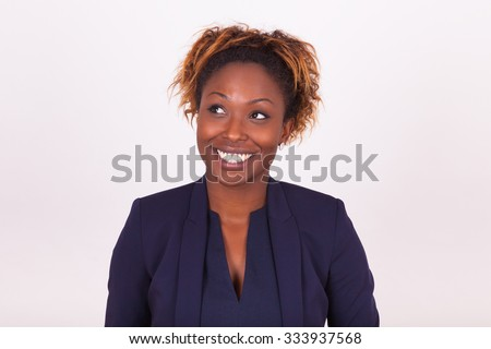 African American business woman looking up, isolated on gray background - stock photo