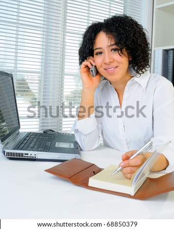 African American Business Woman Sat At Her Desk