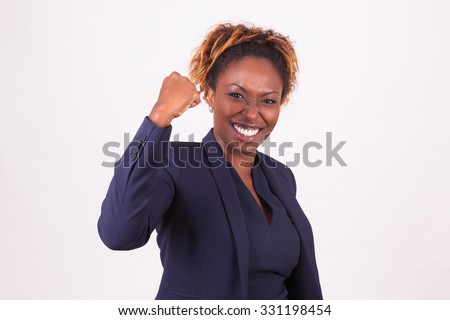 African American business woman with clenched fist, isolated on gray background - stock photo