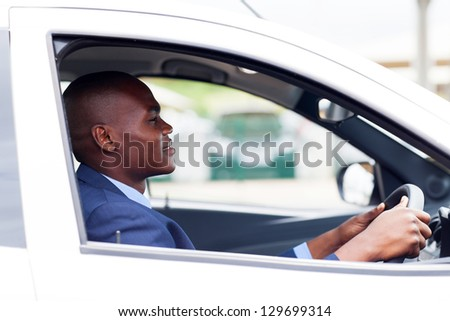 african american businessman driving to work - stock photo