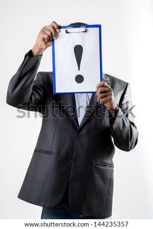 African-American businessman holding a exclamation mark