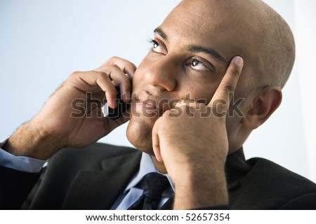 African American businessman holding cellphone to ear. - stock photo