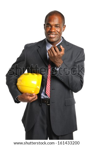 African American businessman holding hardhat and radio isolated over white background