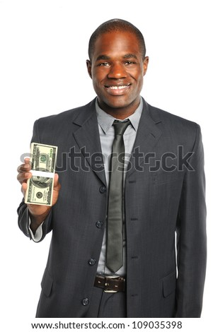 African American businessman holding stack of one hundred dollar bills isolated over white background