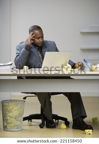 African American businessman looking at laptop - stock photo