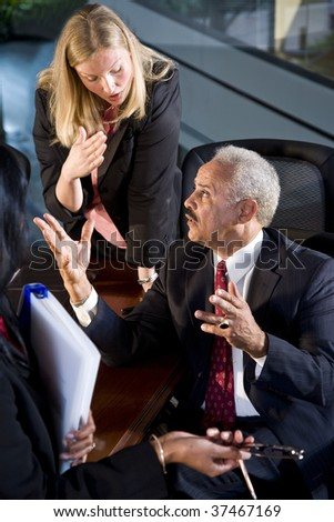 African American businessman meeting with female business colleagues - stock photo