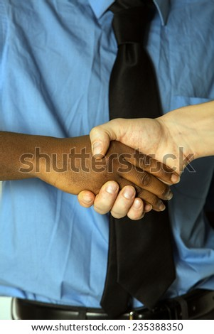 African American businessman or man shaking hands with  colleague making a business deal