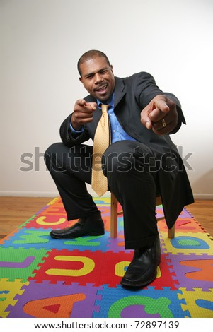 African American businessman pointing at camera. Focus on fingers. - stock photo