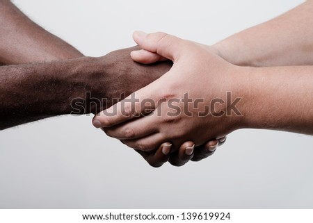 African American businessman shaking hands with caucasian businessman - stock photo