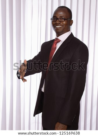 African american businessman stretching his arm - stock photo