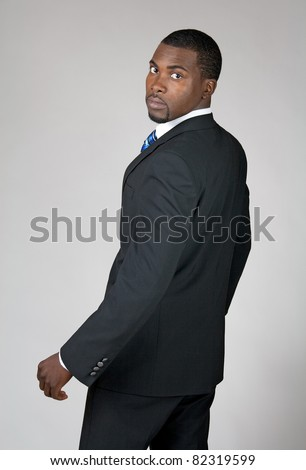 African American businessman turning and looking back.