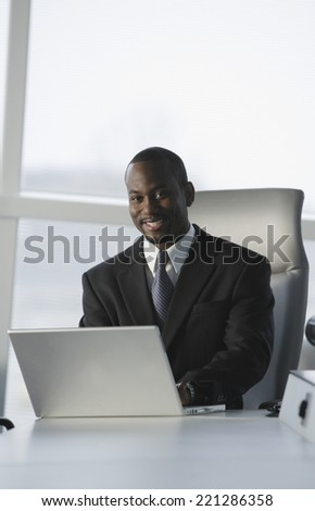 African American businessman typing on laptop - stock photo