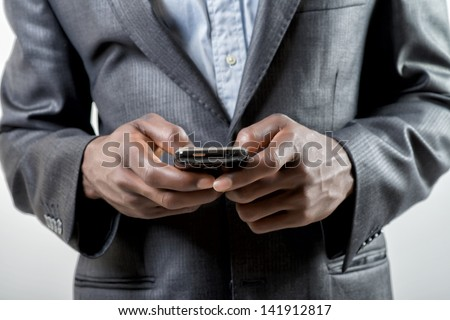 African-American businessman using smartphone