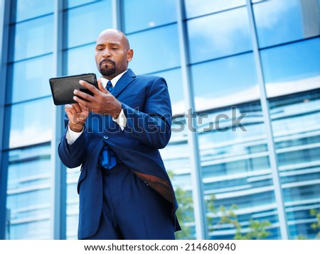 african american businessman using tablet - stock photo