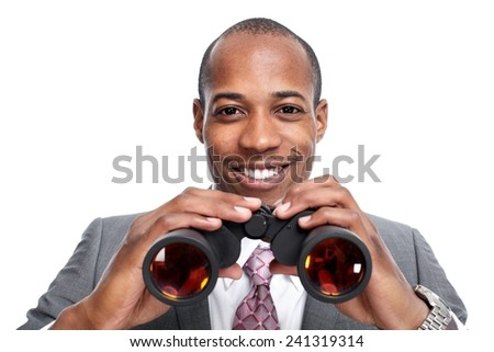 African-American businessman with binoculars  isolated white background. - stock photo