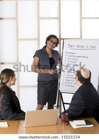 African American Businesswoman giving a presentation.  Shot with shallow depth of field. - stock photo