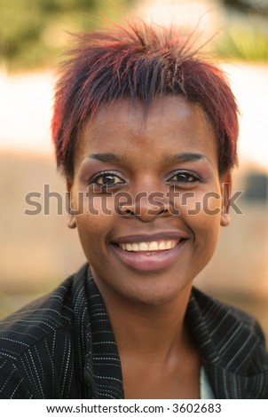 African American businesswoman portrait - looking straight at you - stock photo