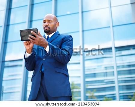african american businnesman using tablet - stock photo