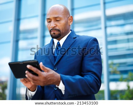 african american businnesman using tablet close up - stock photo