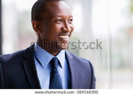 african american corporate worker looking outside office window