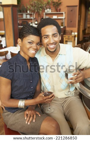 African American couple drinking wine - stock photo