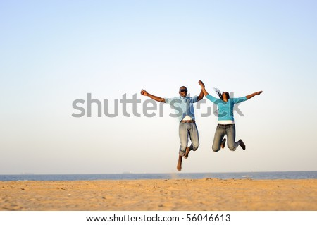 African American couple having fun at the beach - stock photo