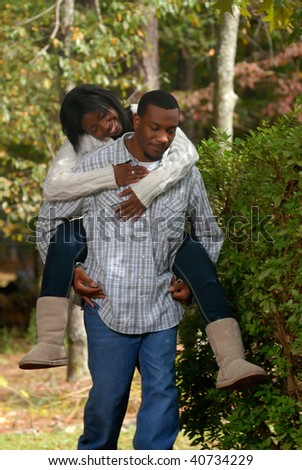 African-American couple outside bonding on a fall day