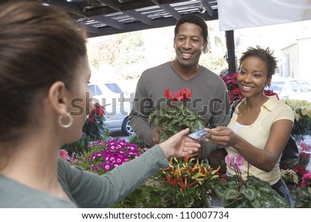 African American couple paying at botanical garden - stock photo