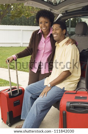 African American couple sitting in a car back