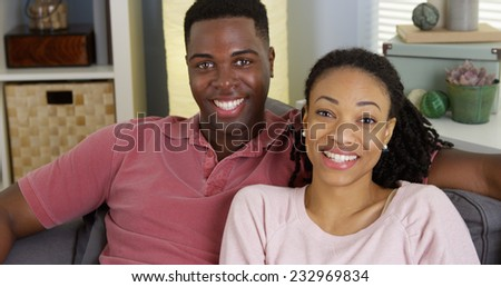 African American couple telling story to camera and talking - stock photo